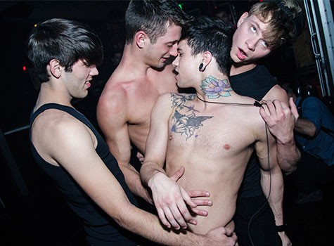 Jake Bass shirtless with a group of boys